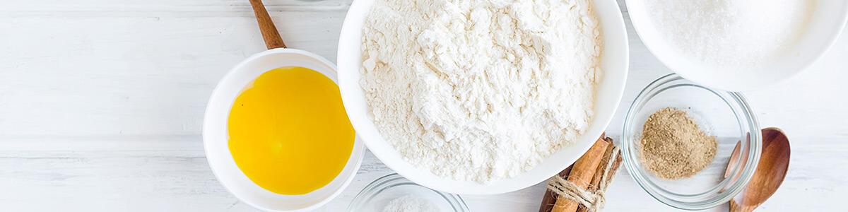 flour, butter, cinnamon and sugar on table