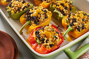 stuffed Mexican peppers in a baking dish on the table