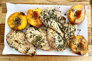 sweet and savory grilled chicken with peaches on a plate