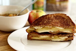 a soup and a apple brie grilled cheese