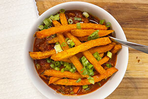 a bowl of beef and sweet potato chili